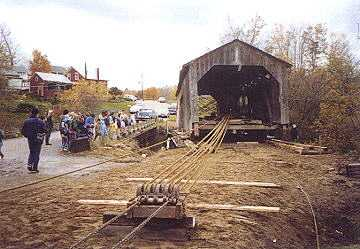 Brown's River Bridge being removed from the river