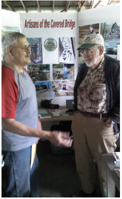 Joe Nelson and visitor at the 2014 Vermont History Expo
