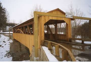 Knapps Bridge [WGN PA-08-01] Built in 1853 using the Burr Truss to cross Brown�s Creek near Luthers Mills, PA. Renovated in 2002. Photo by Chuck and Nancy Knapp, March 21, 2003