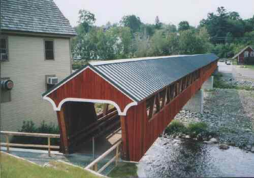 New Covered Bridge over the Ammonoosuc River in Littleton, NH. This footbridge has a Warren Truss. Photo by C. Brock.