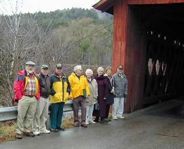 At the Station Bridge in Northfield - W. McKone, J. Weaver, R. Moore, R. Bechard, M. Converse, R. Nelson, K. Ramsey, F. Converse.  Photo by Joe Nelson, Nov. 00