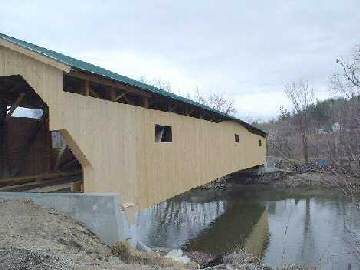 Poland Bridge - On upstream side looking north. Windows cut, siding following the top of the arch.  Photo by Jim Ligon,  April 1, 2004