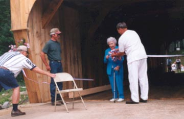 Alona Litwick cuts the ribbon. Photo by Jackie Higgins, July 22, 2000
